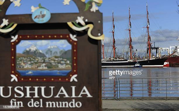 A sign reading 'Ushuaia end of the world' is seen near the Russian vessel Sedov at the harbour in Ushuaia Tierra del Fuego some 3070 kms south of...