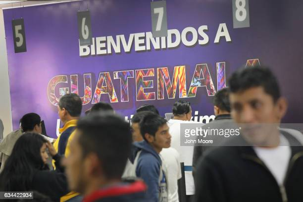 A sign reading 'Welcome to Guatemala' greets deportees after they arrived on an ICE deportation flight on February 9 2017 to Guatemala City Guatemala...