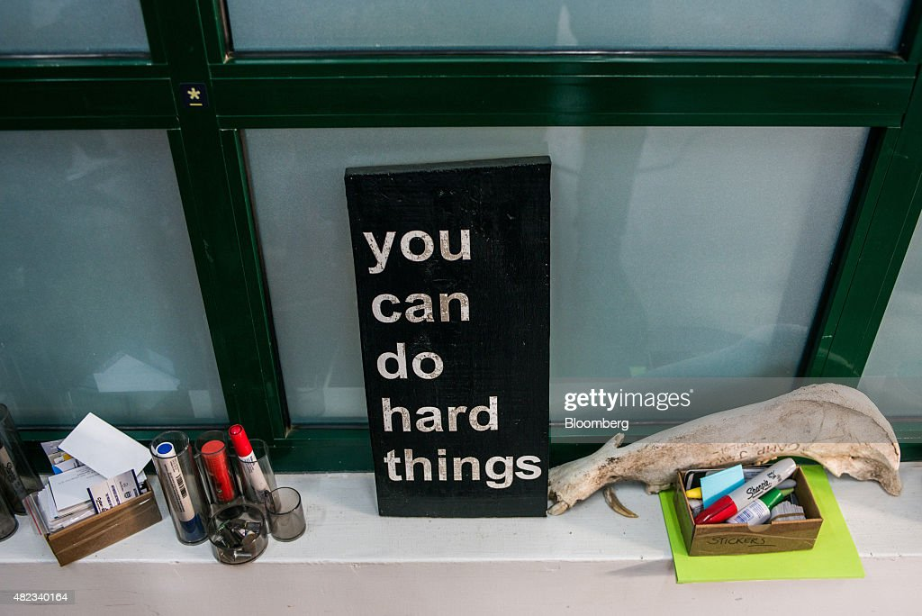 A sign reading 'You Can Do Hard Things' sits beside an animal jawbone at the i-Hub technology innovation center in Nairobi, Kenya, on Thursday, July 23, 2015. Together, the entrepreneurs come up with concepts like Ushahidi, the open-source software that's used to share information and interactive maps to prevent conflicts and help aid agencies provide relief in disaster zones. Photographer: Waldo Swiegers/Bloomberg via Getty Images