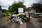 A sign reading 'Your Life Mattered' hangs on a podium outside JJ Hill Montessori School on July 14 2016 in St Paul Minnesota A meal was provided...