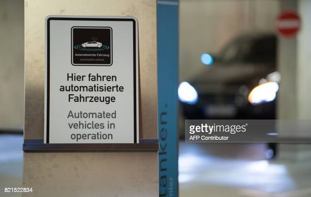 A sign reads 'Automated Vehicle' in Stuttgart on July 24 2017 during a presentation of an automated MercedesBenz E200 equipped with Bosch sensors A...