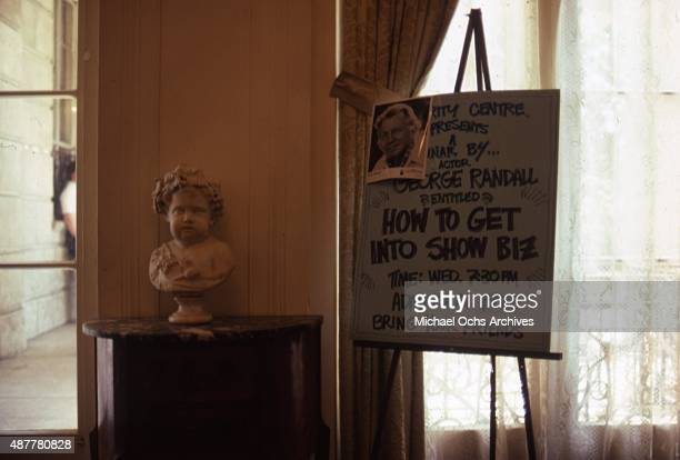 A sign reads 'Celebrity Centre Presents a seminar by Actor George Randall entitled 'How To Get Into Show Biz' Bring your friends' in May 1984 in the...