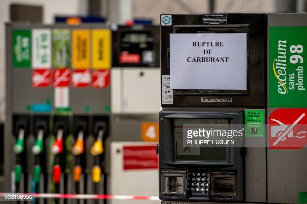 A sign reads 'gas shortage' at a gas station on May 21 2016 in Lille northern France following the blockades of several oil depots by protesters...