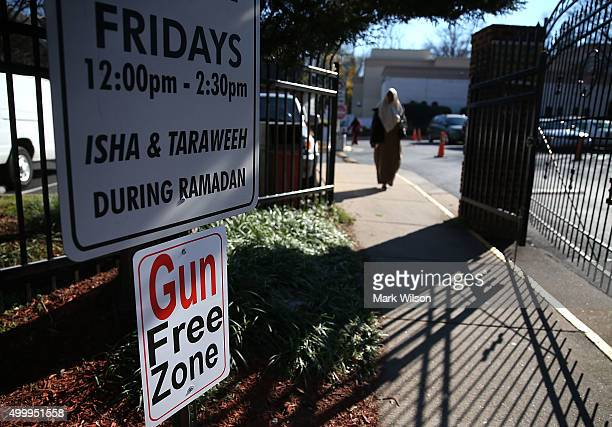 A sign reads Gun Free Zone at the entrance to the Dar AlHijrah Mosque December 4 2015 in Falls Church Virginia Members of Congress and media were...