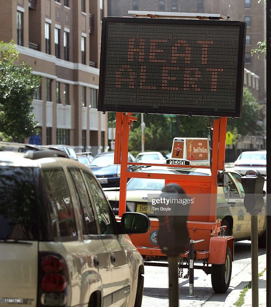 A sign reads 'Heat Alert' warns drivers and pedestrians about the excessive heat August 1, 2006 in Chicago, Illinois. Hot and humid weather has hit parts of the Midwest with temperatures around the Chicago area in the high 90's and heat index readings nearing 105.