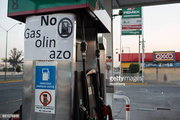 A sign reads 'No Gasolinazo' referring to the gasoline price surge at a closed Petroleos Mexicanos gas station in Mexico City Mexico on Thursday Jan...