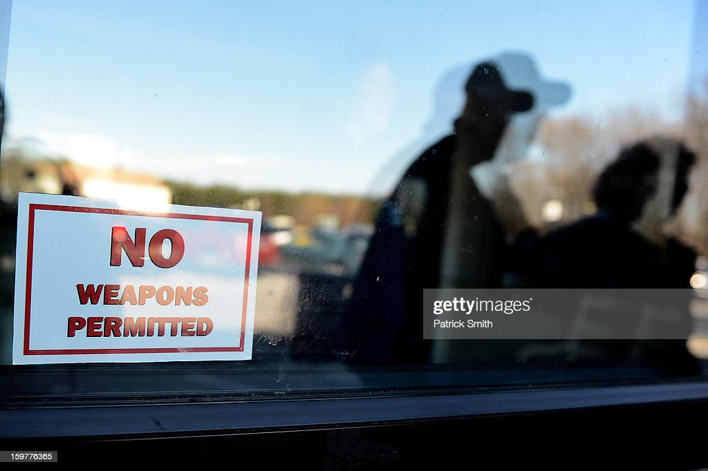 A sign reads 'No Weapons Permitted' during the Delaware State Sportsmen's Association Second Amendment rally at the Modern Maturity Center on January 20, 2013 in Dover, Delaware. U.S. President Barack Obama recently unveiled a package of gun control proposals that include universal background checks and bans on assault weapons and high-capacity magazines.