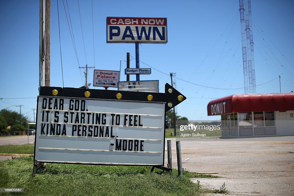 A sign referencing the latest tornado to devastate the town of Moore is posted in front of a pawn shop on June 2, 2013 in Moore, Oklahoma. Residents of Moore, Oklahoma continue to recover and sift through the remains of their homes two weeks after a devastating EF-5 tornado ripped through the town killing 24 people and destroying hundreds of homes and businesses.