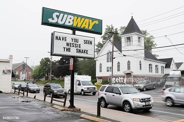 A sign referring to the sighting of a large snake estimated at 10 feet in length in Westbrook Maine is seen Wednesday June 29 2016
