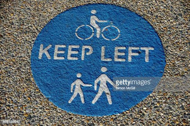 Sign reminding cyclists and pedestrians to keep left on a shared pedestrian and cycling path in Canberra, Australian Capital Territory, Australia