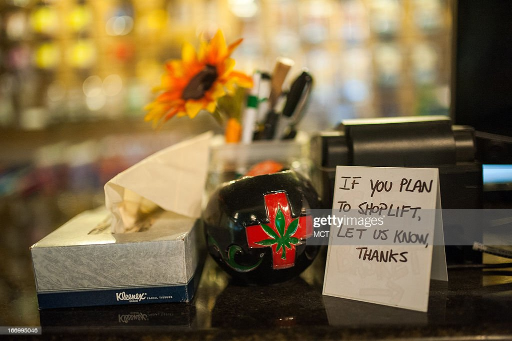 A sign requests that would-be shoplifters identify themselves on a small sign seen here in the at Ganja Gourmet in Denver, Colorado, on April 17, 2013.