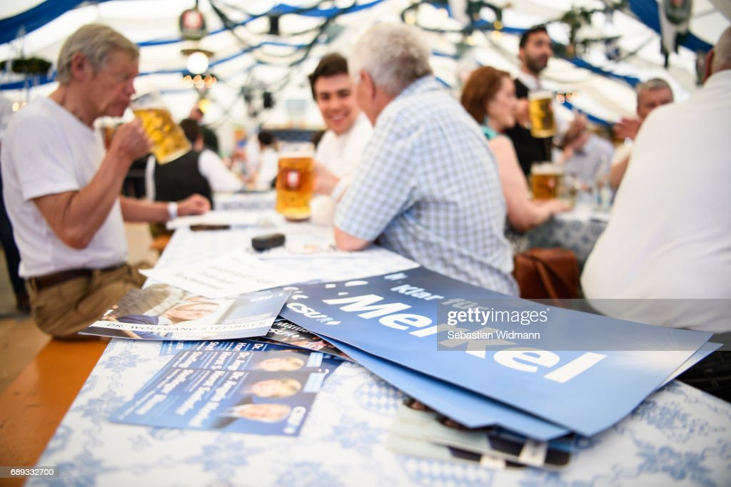 A sign saying 'clear for Merkel' lies on a table at the Trudering fest on May 28, 2017 in Munich, Germany. The CDU and CSU, along with the German Social Democrats (SPD), form the current German coalition government, though relations between Merkel and Seehofer have been complicated as the two have clashed over certain issues, especially immigration.