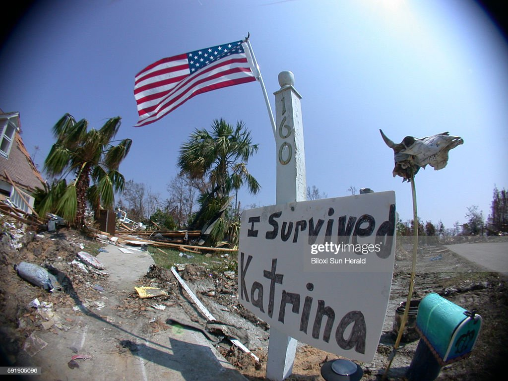 A sign saying 'I Survived Katrina' stands outside of a home in Waveland Miss that was destroyed by Hurricane Katrina in 2005