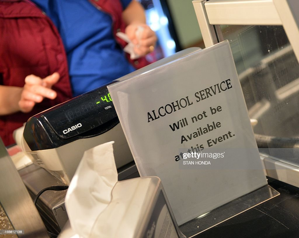 A sign saying no alcohol will be served by a vendor is seen before a rally for US Republican Presidential candidate Mitt Romney November 5, 2012 at the Verizon Wireless Arena in Manchester, New Hampshire. AFP PHOTO/Stan HONDA