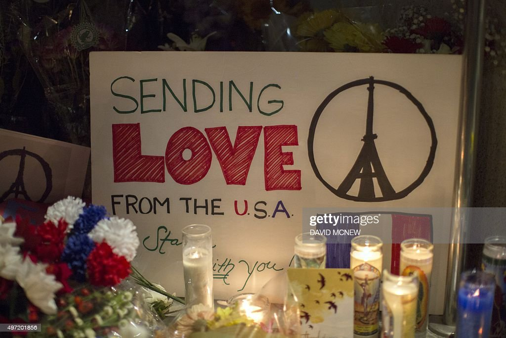 A sign sends a message of love from the Untied States to France at a makeshift memorial outside the French Consulate in Los Angeles California on...