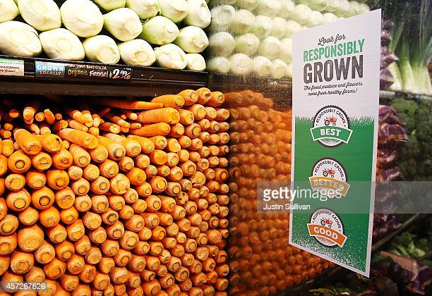 A sign showing a the new Responsibly Grown rating system is displayed in the produce section at a Whole Foods market on October 15 2014 in San...