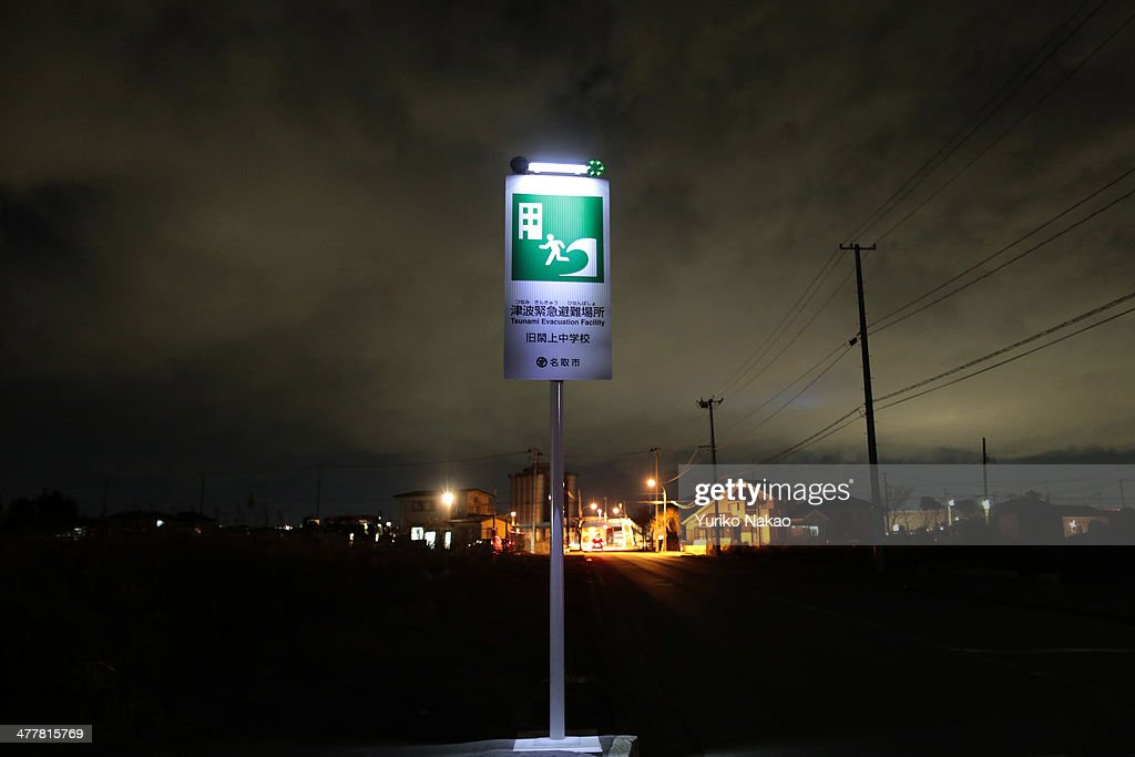 A sign showing a tsunami evacuation center stands in front of Yuriage Junior High School on March 11, 2014 in Natori, Miyagi prefecture, Japan. On March 11 Japan commemorates the third anniversary of the magnitude 9.0 earthquake and tsunami that claimed more than 18,000 lives, and subsequent nuclear disaster at the Fukushima Daiichi Nuclear Power Plant.