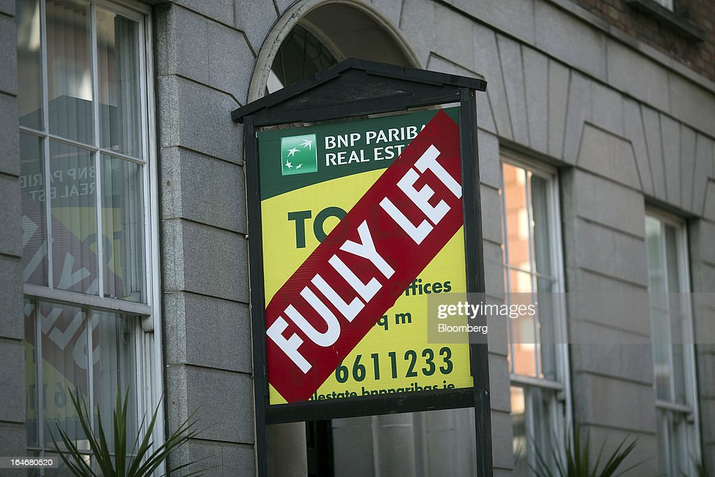 A sign showing commercial office space as 'Fully Let' is seen on a BNP Paribas Real Estate board in Dublin, Ireland, on Saturday, March 16, 2013 Ireland's renewed competiveness makes it a beacon for the U.S. companies such as EBay, Google Inc. and Facebook Inc., which have expanded their operations in the country over the past two years. Photographer: Simon Dawson/Bloomberg via Getty Images