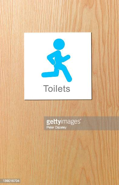Sign showing desperate man running for toilet