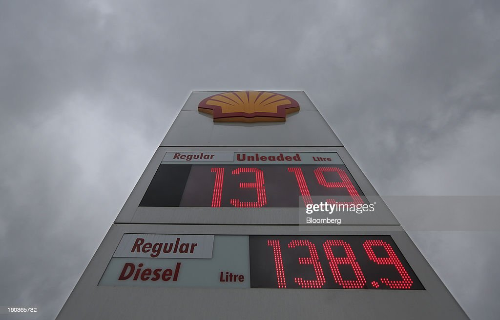 A sign showing fuel prices stands outside a Royal Dutch Shell Plc gas station in London, U.K., on Tuesday, Jan. 29, 2013. Oil traded near the highest level in four months ahead of a Federal Reserve policy statement that may signal the U.S. central bank will take additional steps to stimulate the economy. Photographer: Chris Ratcliffe/Bloomberg via Getty Images