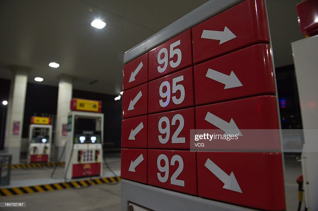 A sign showing prices for diesel and different types of gasoline at a gas station on March 26, 2013 in Beijing, China. China cut the benchmark retail price for gasoline by 310 yuan (49.85 U.S. dollars) per ton and the price for diesel by 300 yuan per ton starting from Today.