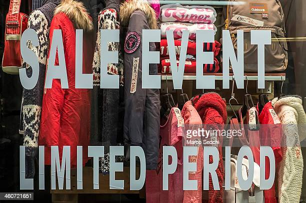 A sign showing sales is on display in a city centre shop on January 5 2014 in Venice Italy Sales got off to a slow start in Italy while poverty has...