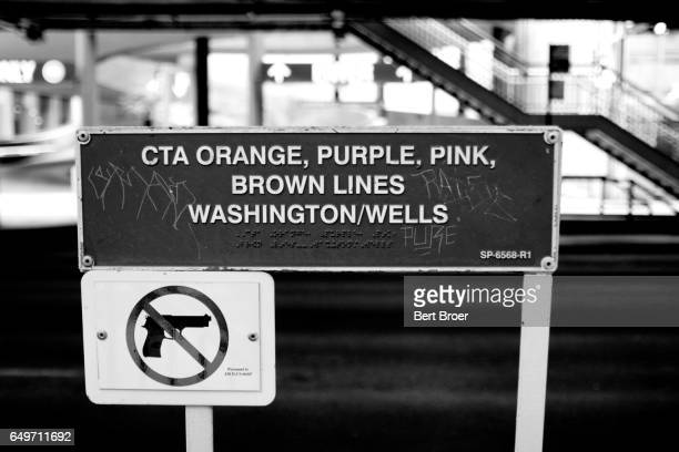 A sign showing that guns are not allowed, in black and white