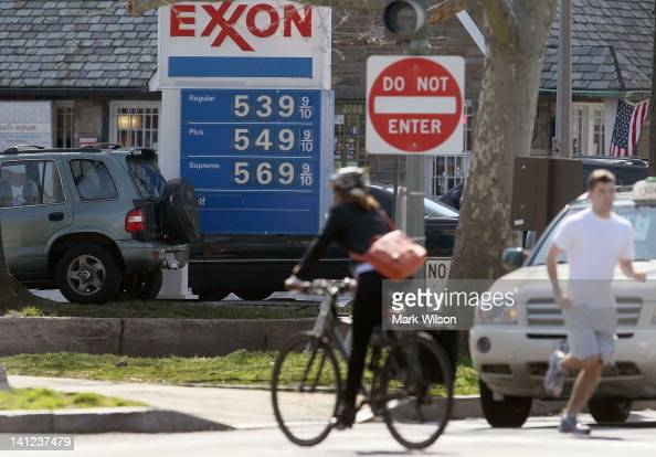 A sign shows gas prices over five dollars a gallon for all three grades at a EXXON service station on March 13 2012 in Washington DC According to AAA...