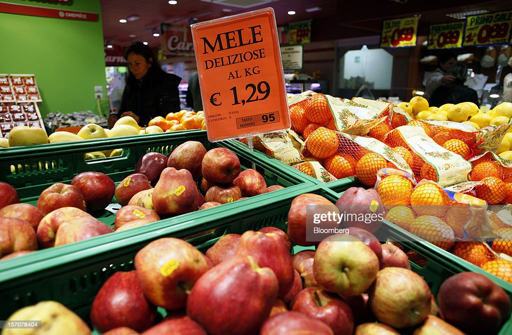A sign shows the cost for apples in euros as displayed in the fruit and vegetable section of a OnePrice supermarket, operated by Gruppo BSE, in Monterotondo, Italy, on Wednesday, Nov. 28, 2012. Italy needs to uphold Prime Minister Mario Monti's pledge to shore up public finances in order to enjoy investor confidence even after elections due by April, the Organization for Economic Cooperation and Development said in its latest Economic Outlook report this week. Photographer: Alessia Pierdomenico/Bloomberg via Getty Images