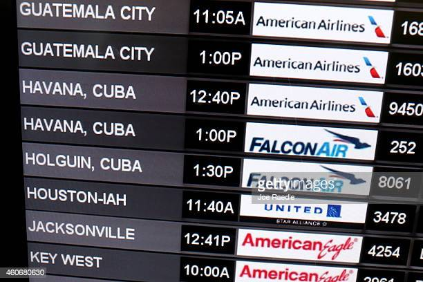 A sign shows the departure times for flights to Cuba at Miami International Airport on December 19 2014 in Miami Florida US President Barack Obama...