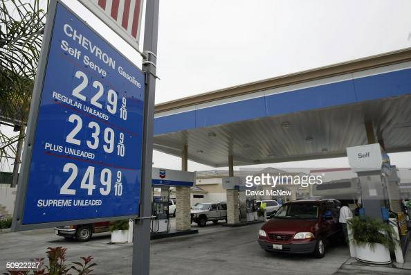 A sign shows the regular prices of gas at a station temporarily selling gasoline for 35 cent per gallon on June 3 2004 in Cypress California Drivers...