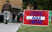 A sign shows the way to the polling station at Austin Community College on November 4 2014 in Austin Texas Voters headed to the polls today to decide...