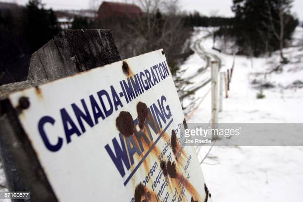 A sign sign marks the border between Canada and the US March 22 2006 near Beecher Falls Vermont As American politicians continue to debate...