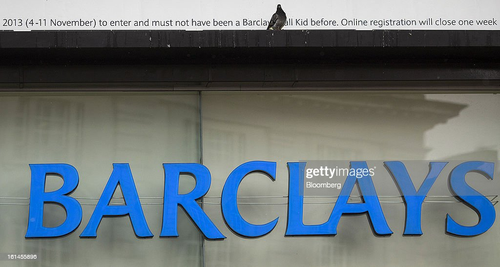 A sign sits above a Barclays Plc bank branch in London, U.K., on Monday, Feb. 11, 2013. Barclays Plc Chief Executive Officer Antony Jenkins's pledges to shred the legacy of his predecessor and fix the lender's culture are distracting from the difficulty he has in reviving profit at Britain's biggest investment bank. Photographer: Simon Dawson/Bloomberg via Getty Images