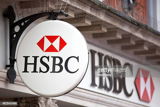 A sign sits above a HSBC bank operated by HSBC Holdings Plc in Godalming UK on Monday Aug 3 2015 HSBC Europe's largest bank reported an 18 percent...