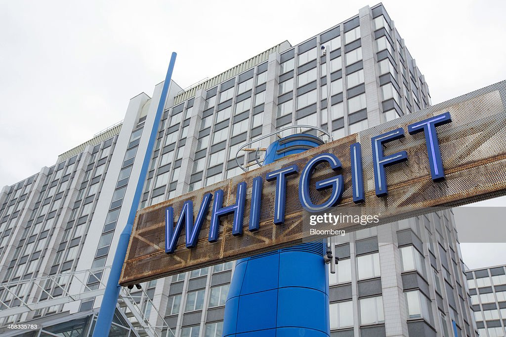 A sign sits above the car park entrance to the Whitgift Centre shopping mall in Croydon, south London, U.K., on Monday, Feb. 10, 2014. Westfield Group, Australia's biggest mall operator, and Hammerson Plc won preliminary approval to rebuild the Whitgift Centre mall in south London as part of a project valued at about 1 billion pounds ($1.6 billion). Photographer: Jason Alden/Bloomberg via Getty Images