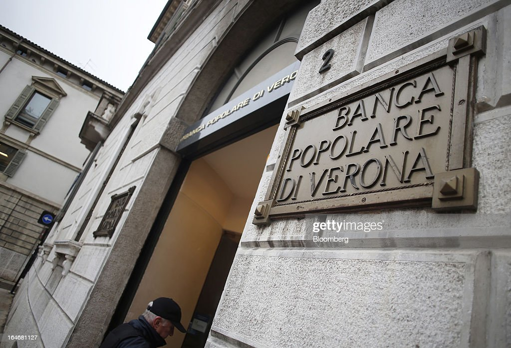 A sign sits above the entrance to a branch of Banca Popolare di Verona, a subsidiary of Banco Popolare SC, in Verona, Italy, on Monday, March 25, 2013. Italy's economy remains mired in its longest recession in two decades and a month-old political impasse threatens to increase sovereign-debt yields and bank funding costs. Photographer Alessia Pierdomenico/Bloomberg via Getty Images