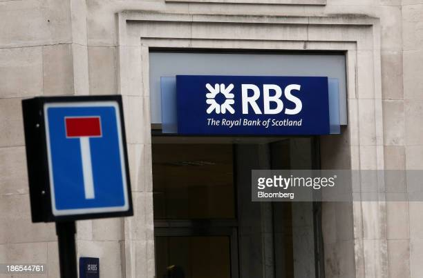 A sign sits above the entrance to a branch of Royal Bank of Scotland Group Plc in London UK on Friday Nov 1 2013 Royal Bank of Scotland Group expects...