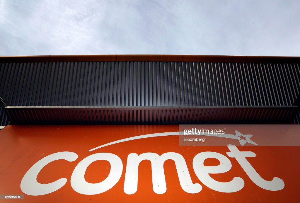 A sign sits above the entrance to a closed-down Comet electronics store in Yeading, U.K., on Friday, Nov. 23, 2012. Comet, a U.K. electronics chain, appointed Deloitte LLP as insolvency administrator, less than a year after being bought by private-equity firm OpCapita LLP. Photographer: Chris Ratcliffe/Bloomberg via Getty Images