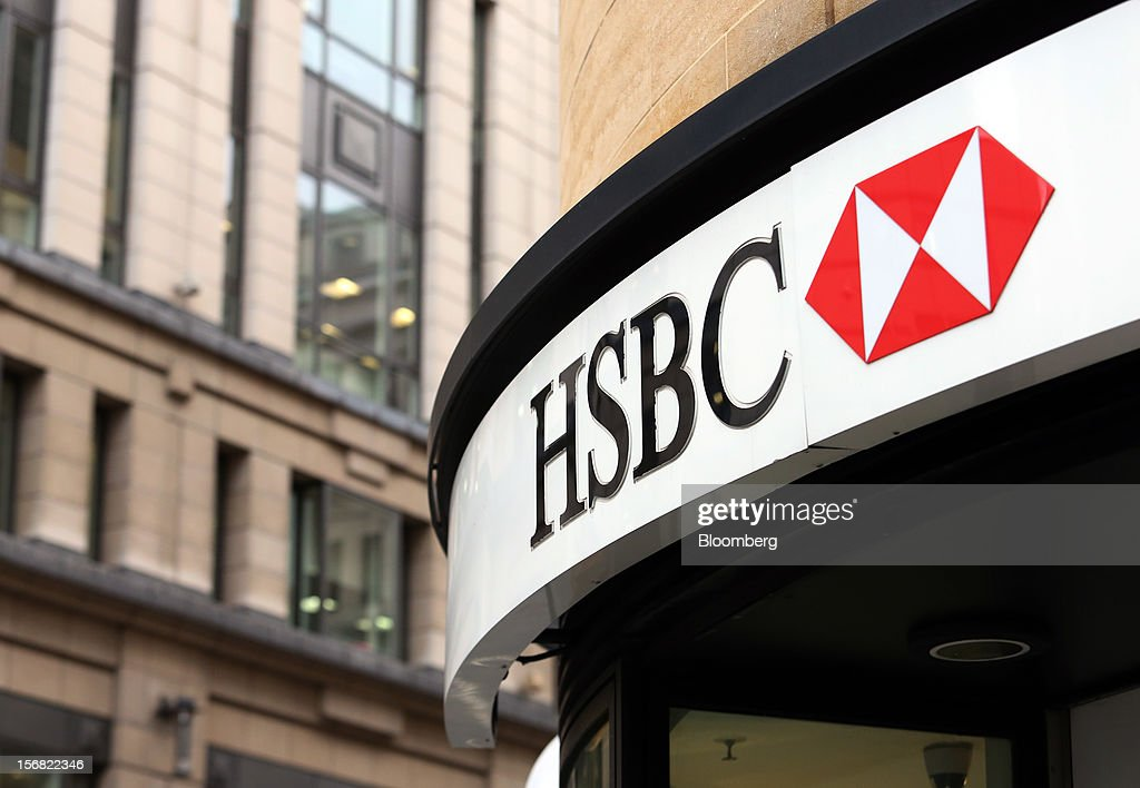 A sign sits above the entrance to a HSBC Holdings Plc bank branch in London, U.K., on Thursday, Nov. 22, 2012. Shares of HSBC have climbed 26 percent this year in London trading, and 30 percent in Hong Kong, as Chief Executive Officer Stuart Gulliver pared costs and sold assets to revive profit and focus on emerging economies in which the bank has a greater market share. Photographer: Chris Ratcliffe/Bloomberg via Getty Images