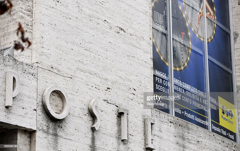 A sign sits above the entrance to a Poste Italiane SpA post office in Rome, Italy, on Thursday, April 4, 2013. Italy's state-owned postal service and Wind SpA, the country's third-largest mobile-phone company, are discussing a possible venture with Wind's fixed-line network Infostrada, Poste Italiane SpA Chief Executive Officer Massimo Sarmi said. Photographer: Alessia Pierdomenico/Bloomberg via Getty Images