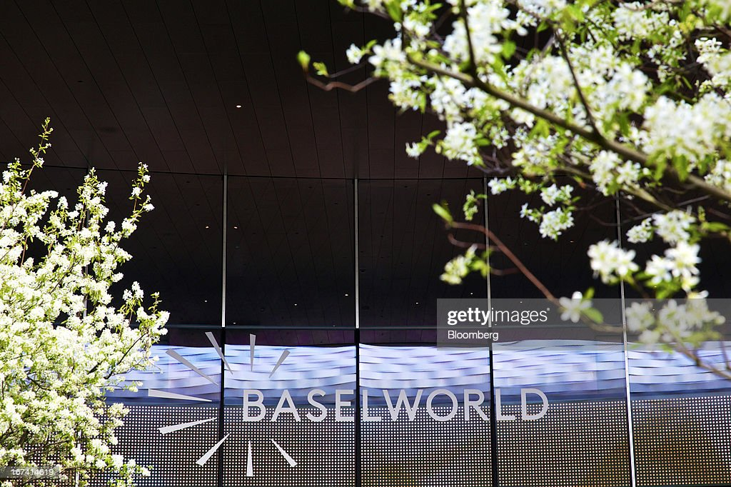 A sign sits above the entrance to a show hall at the Baselworld watch fair in Basel, Switzerland, on Wednesday, April 24, 2013. The annual fair attracts 2,000 companies from the watch, jewelry and gem industries to show their new wares to more than 100,000 visitors. Photographer: Gianluca Colla/Bloomberg via Getty Images