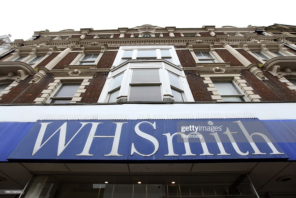 A sign sits above the entrance to a WH Smith Plc store in Dover, U.K., on Tuesday, April 9, 2013. WH Smith Plc, the book and magazine retailer with more than 1,100 U.K. outlets, is scheduled to announce earnings on April 11. Photographer: Chris Ratcliffe/Bloomberg via Getty Images