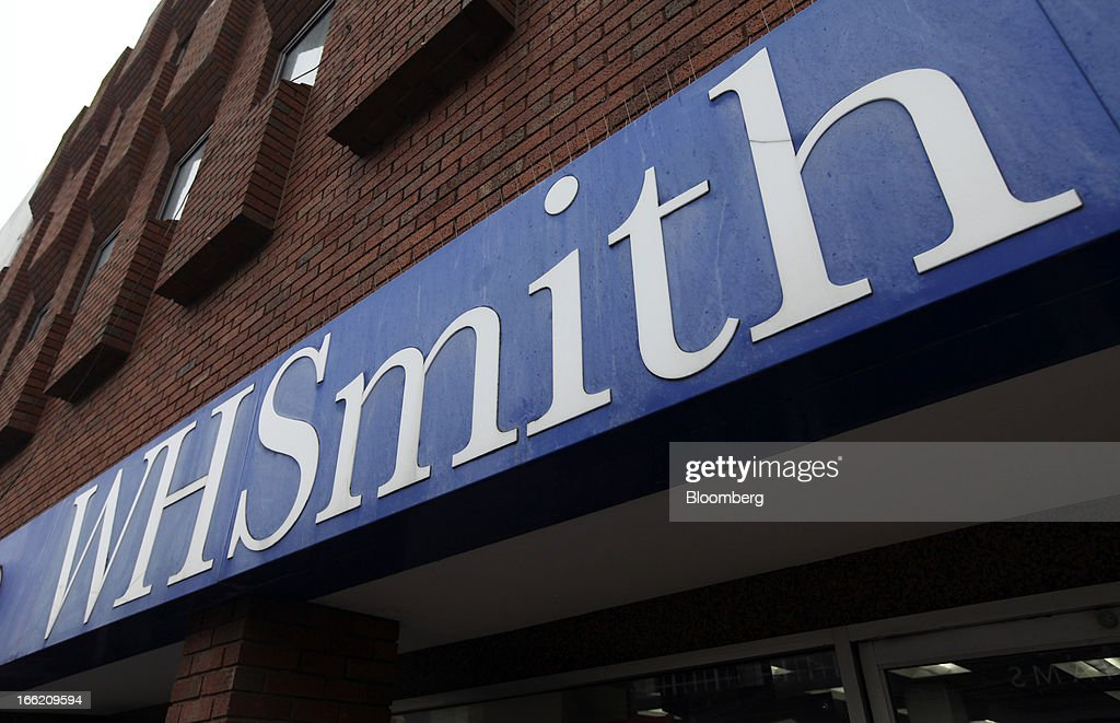 A sign sits above the entrance to a WH Smith Plc store in Folkestone, U.K., on Tuesday, April 9, 2013. WH Smith Plc, the book and magazine retailer with more than 1,100 U.K. outlets, is scheduled to announce earnings on April 11. Photographer: Chris Ratcliffe/Bloomberg via Getty Images