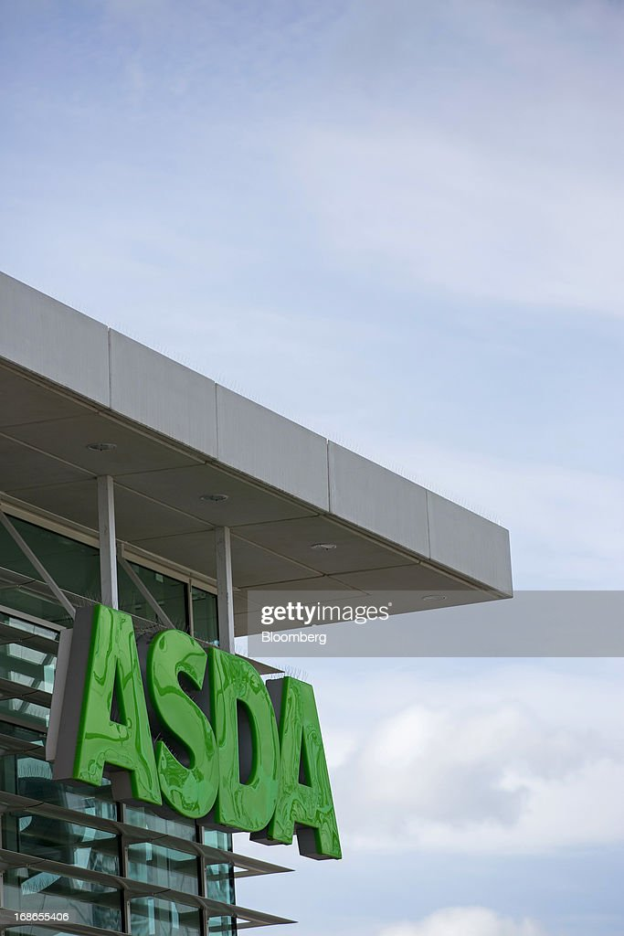 A sign sits above the entrance to an Asda supermarket store, operated by Wal-Mart Stores Inc., in the Meton borough of London, U.K., on Monday, May 13, 2013. Asda, the U.K. supermarket chain owned by Wal-Mart Stores Inc., said sales rose 4.5 percent last year and it's investing 700 million pounds ($1 billion) into stores and online operations. Photographer: Jason Alden/Bloomberg via Getty Images