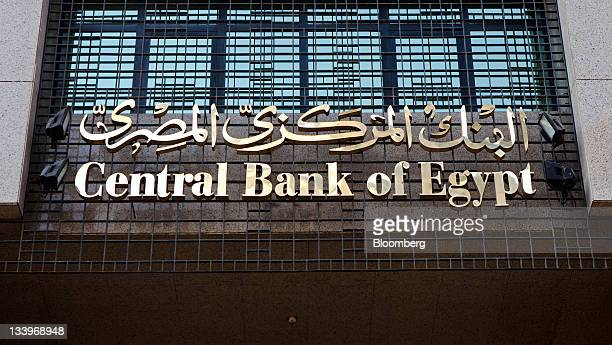A sign sits above the entrance to Egypt's central bank in Cairo Egypt on Tuesday Nov 22 2011 Egypt's benchmark dollar bonds slumped sending the yield...