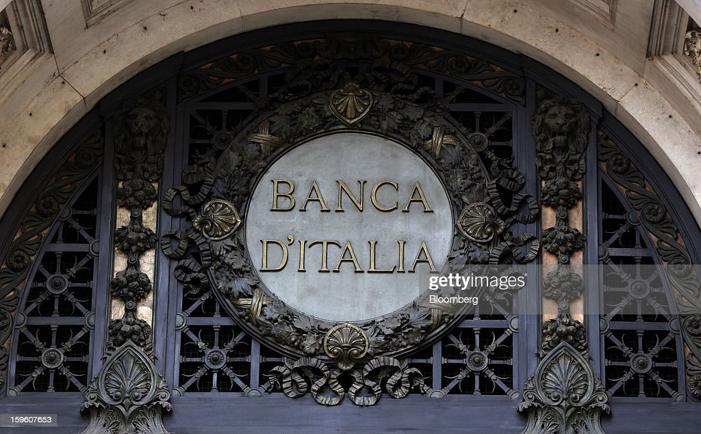 A sign sits above the entrance to the Banca d'Italia, Italy's central bank, in Milan, Italy, on Thursday, Jan. 17, 2013. The euro-area economy won't return to growth until the next quarter as a recovery in Italy is delayed and France continues to shrink, according to a survey of economists. Photographer: Alessia Pierdomenico/Bloomberg via Getty Images