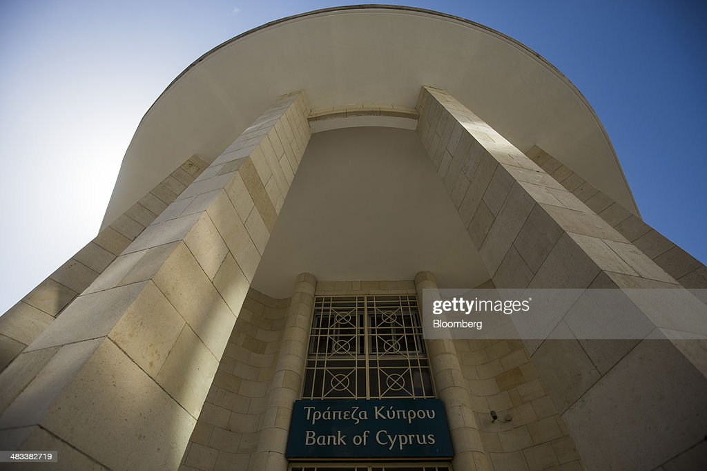 A sign sits above the entrance to the regional main branch of the Bank of Cyprus in Limassol, Cyprus, on Tuesday, April 8, 2014. Cyprus is the biggest foreign investor in Russia with $69 billion dollars accumulated through the end of last year, while the island is the second-biggest destination for Russian investment at $33 billion, according to the Moscow-based Federal Statistics Service. Photographer: Andrew Caballero-Reynolds/Bloomberg via Getty Images