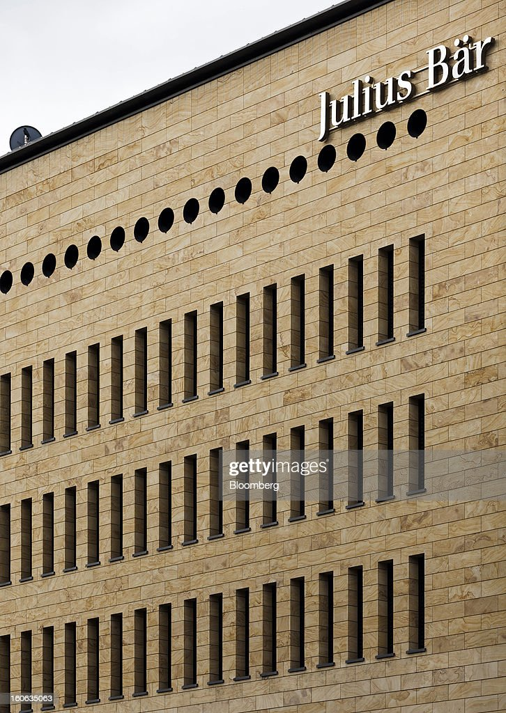 A sign sits above windows at the offices of Julius Baer Group Ltd. in Geneva, Switzerland, on Sunday, Feb. 3, 2013. Julius Baer Group Ltd., the third-largest Swiss wealth manager, reported declining revenue margins on assets under management as full-year profit matched analyst estimates. Photographer: Valentin Flauraud/Bloomberg via Getty Images