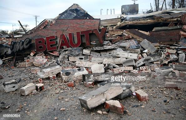 A sign sits amidst rubble at a building that was damaged during a demonstration on November 25 2014 in Dellwood Missouri Demonstrators caused...
